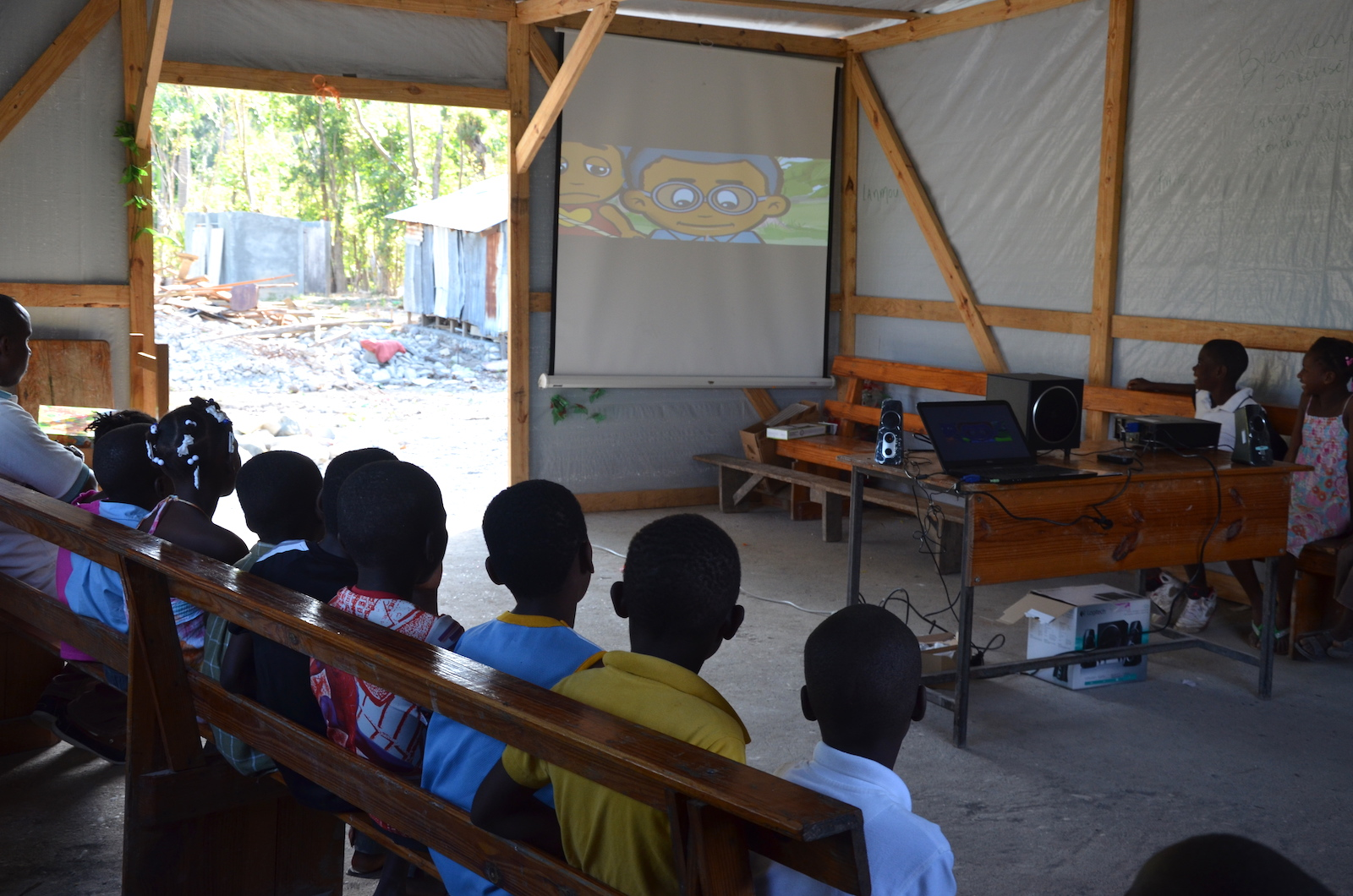 Children viewing Lakou Kajou after Hurricane Matthew